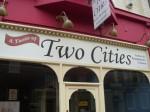 """Geschäftsschild """"A Taste of Two Cities"""""""